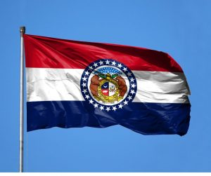 Missouri state flag flying in the wind