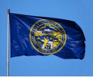 Nebraska state flag flying in the wind